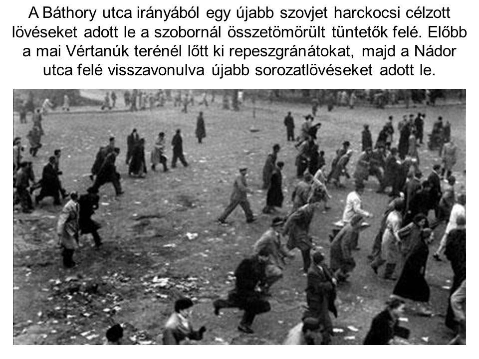 A Báthory utca irányából egy újabb szovjet harckocsi célzott lövéseket adott le a szobornál összetömörült tüntetők felé.