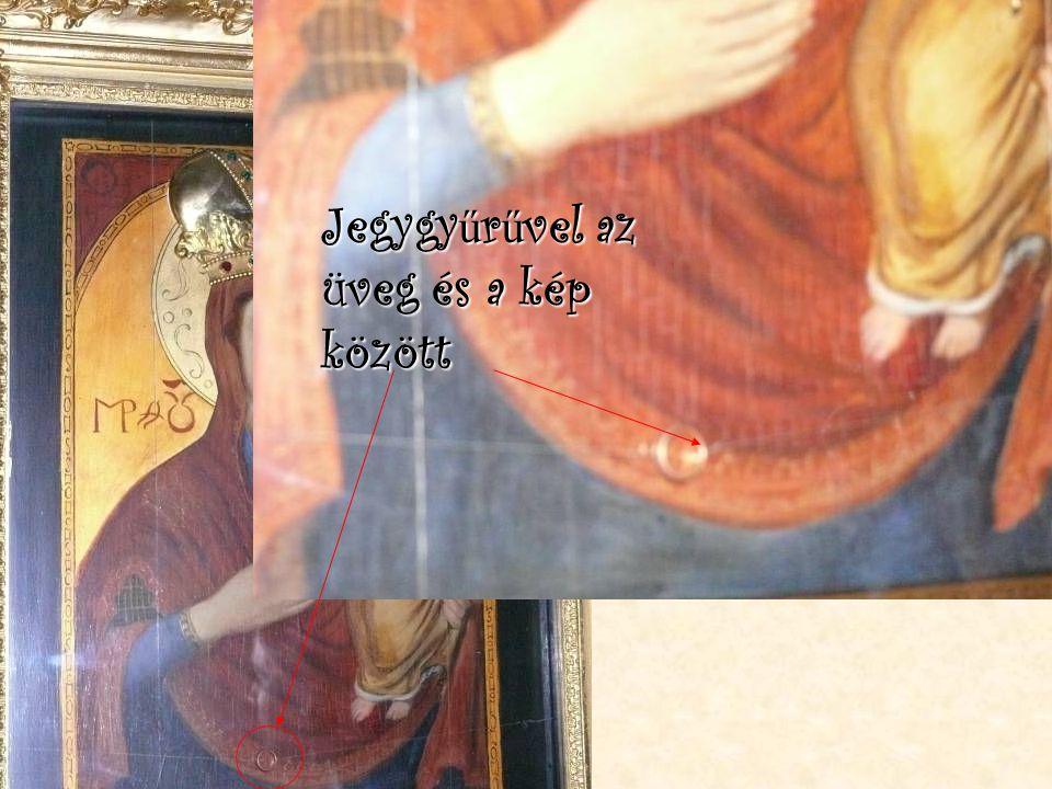 Láttunk szentképet Jegygyűrűvel az üveg és a kép között