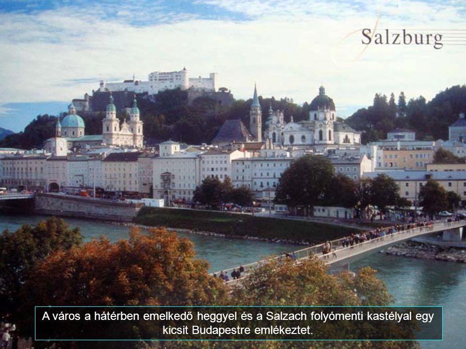 A város a hátérben emelkedő heggyel és a Salzach folyómenti kastélyal egy kicsit Budapestre emlékeztet.