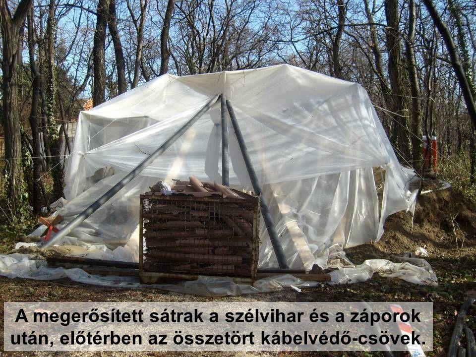 A megerősített sátrak a szélvihar és a záporok után, előtérben az összetört kábelvédő-csövek.