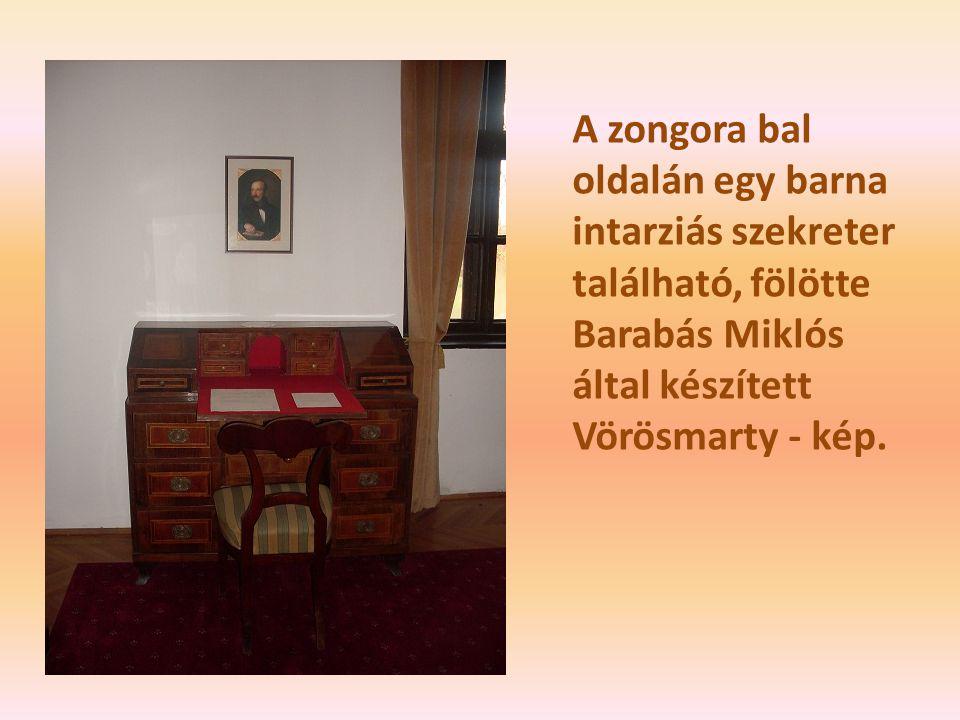 A zongora bal oldalán egy barna intarziás szekreter található, fölötte Barabás Miklós által készített Vörösmarty - kép.