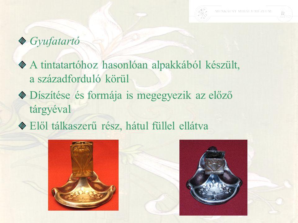 Gyufatartó A tintatartóhoz hasonlóan alpakkából készült, a századforduló körül. Díszítése és formája is megegyezik az előző tárgyéval.