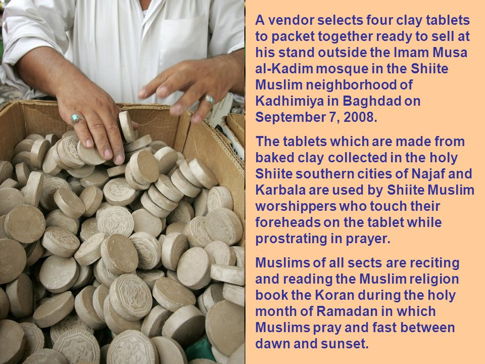 A vendor selects four clay tablets to packet together ready to sell at his stand outside the Imam Musa al-Kadim mosque in the Shiite Muslim neighborhood of Kadhimiya in Baghdad on September 7, 2008.