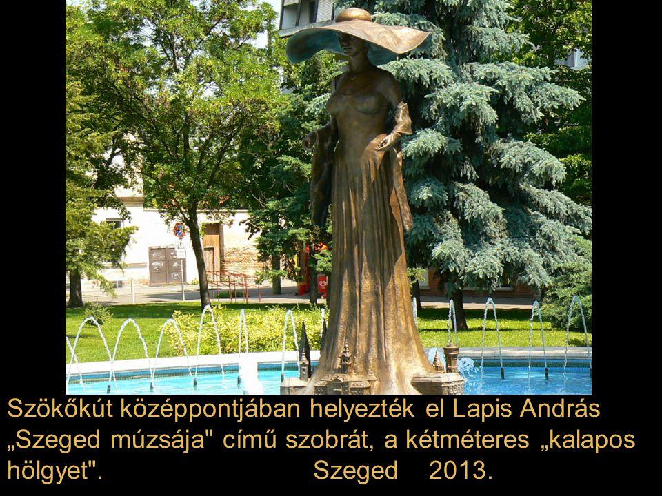 """Szökőkút középpontjában helyezték el Lapis András """"Szeged múzsája című szobrát, a kétméteres """"kalapos hölgyet ."""