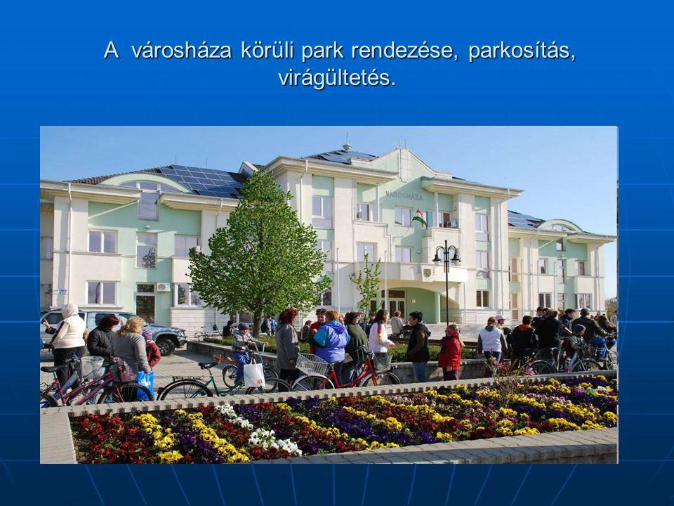 A városháza körüli park rendezése, parkosítás, virágültetés.