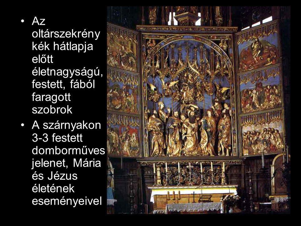 Az oltárszekrény kék hátlapja előtt életnagyságú, festett, fából faragott szobrok