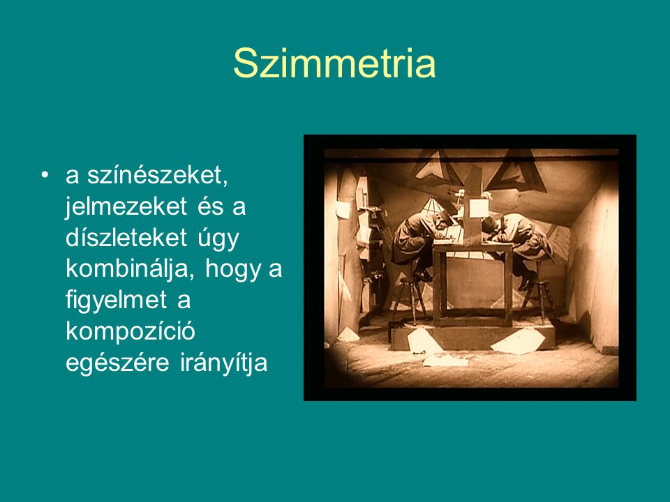 Szimmetria a színészeket, jelmezeket és a díszleteket úgy kombinálja, hogy a figyelmet a kompozíció egészére irányítja.