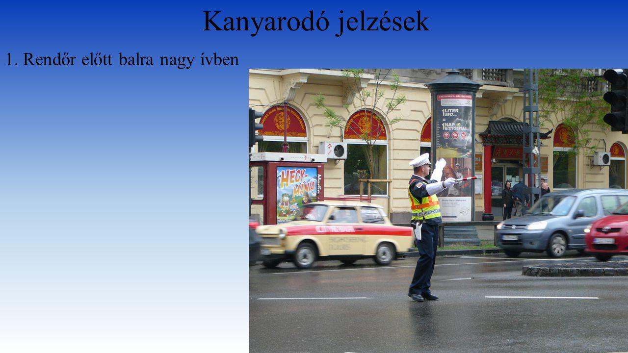 Kanyarodó jelzések 1. Rendőr előtt balra nagy ívben