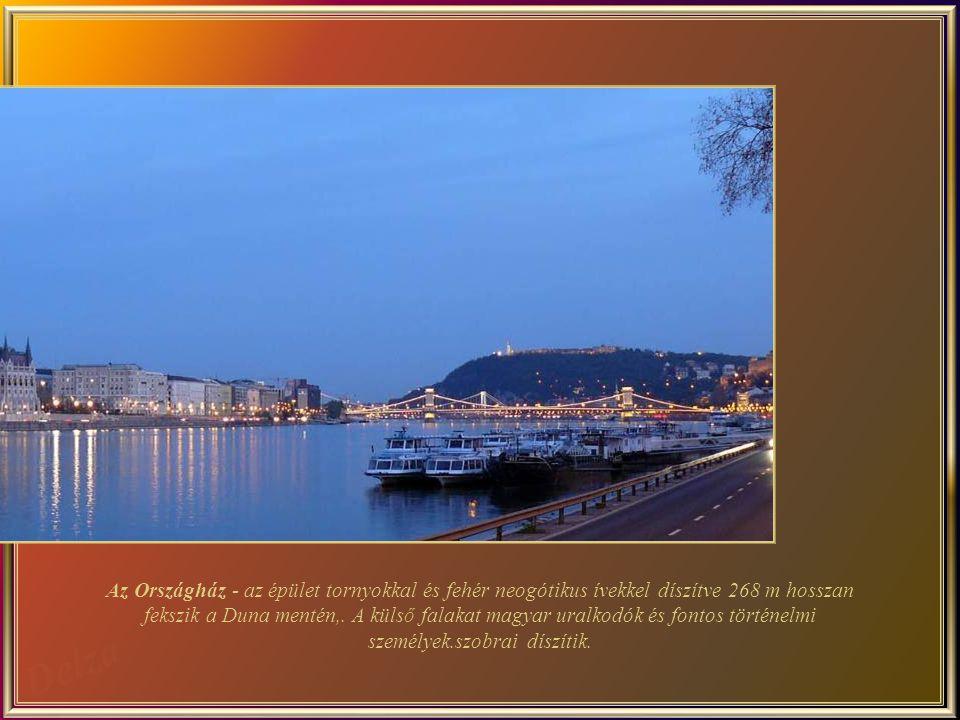 Az Országház - az épület tornyokkal és fehér neogótikus ívekkel díszítve 268 m hosszan fekszik a Duna mentén,.
