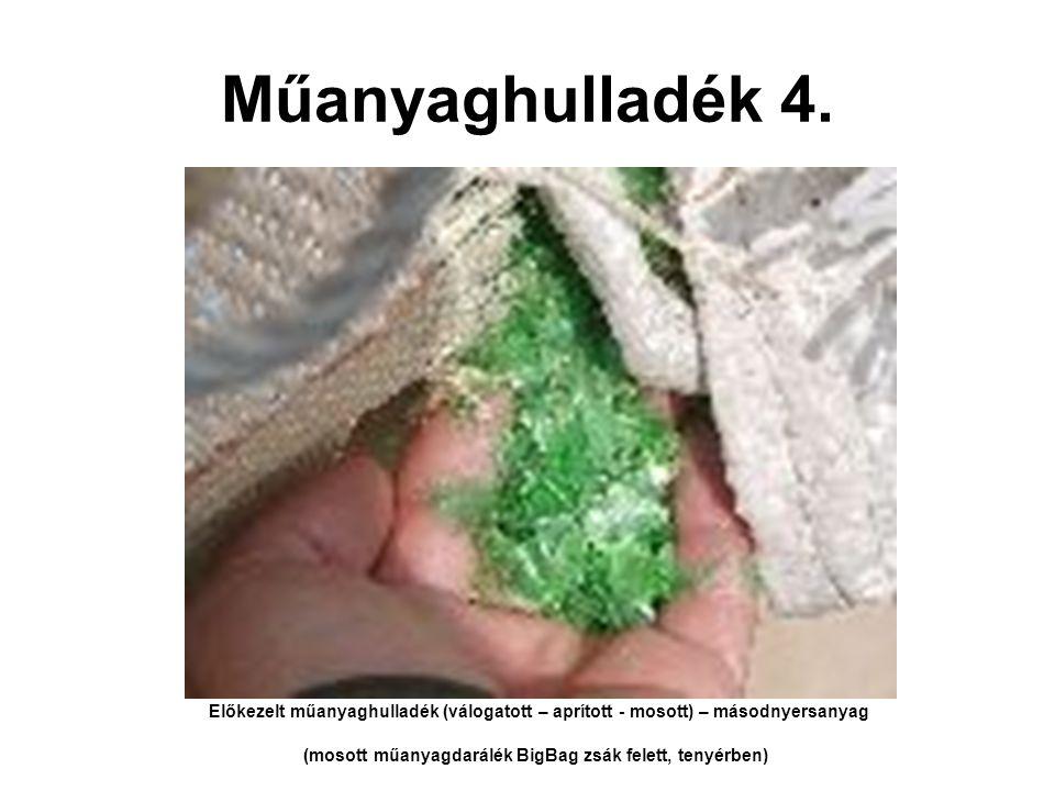 (mosott műanyagdarálék BigBag zsák felett, tenyérben)